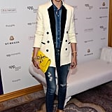 A Canadian tuxedo got a fresh update when Olivia added a sleek white tuxedo jacket over her ensemble.