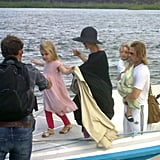 Mom Angelina Jolie and dad Brad Pitt helped their twins Vivienne Jolie-Pitt and Knox Jolie-Pitt off of a boat on their journey home from vacationing in the Galapagos Islands.