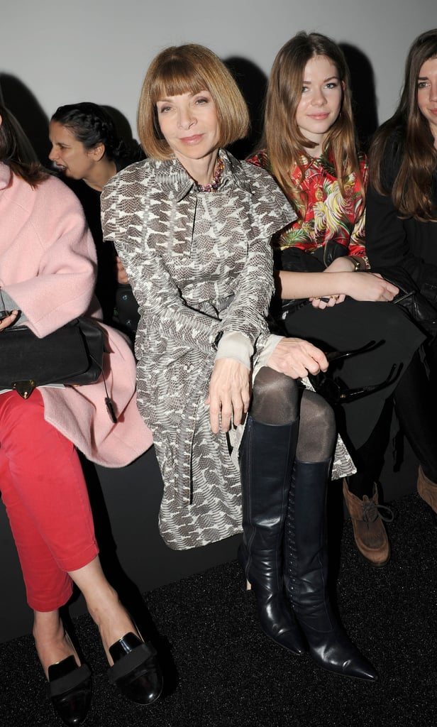 Anna Wintour perched herself in the front row of Erdem looking sophisticated in a snakeskin trench coat and black knee-high boots.