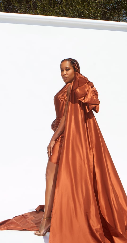 Though we have yet to get another glimpse of Regina King's iconic dog Cornbread since the Golden Globes last month, the actress and director stole the show all on her own at the 2021 NAACP Image Awards on Saturday night. Regina, who's nominated for entertainer of the year and outstanding director for her directorial debut in One Night in Miami, brought on the drama in a custom Oscar de la Renta gown in a gorgeous copper color.  While the taffeta dress was undoubtedly a beaut from the front — can we talk about that amazing statement train? — the giant bow in the back wins the (virtual) red carpet for us. With the help of stylists Wayman Bannerman and Micah McDonald, Regina kept the rest of her look quite simple, with jewelry by Irene Neuwirth and sparkly brown heels from Stuart Weitzman. Get a closer look at her stunning ensemble ahead.      Related:                                                                                                           5 Reasons We Love Regina King — and You Should, Too