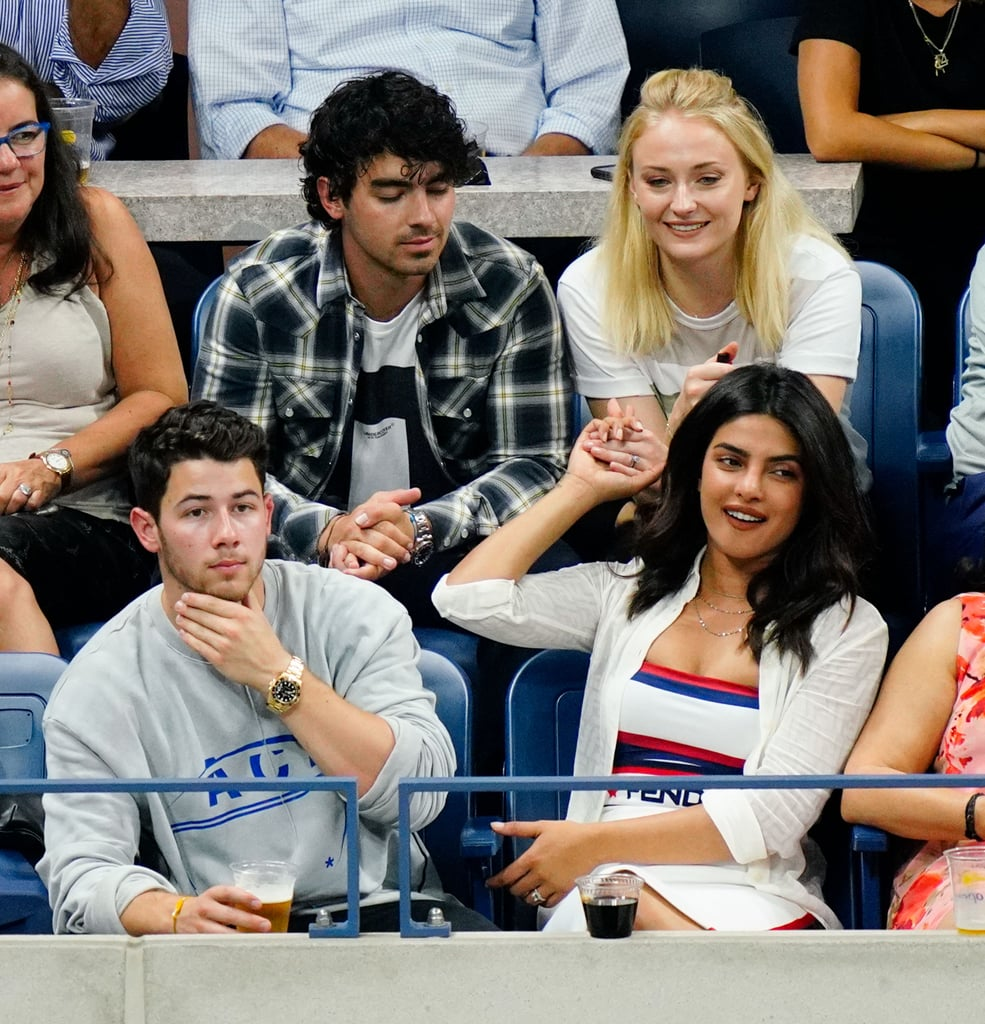 """Sophie Turner and Joe Jonas certainly have a taste for tennis this week — and double dates. The duo attended the US Open on Tuesday, joined by Joe's brother Kevin and his wife Danielle. On Wednesday, the pair had another family outing as they invited along Nick Jonas and fiancé Priyanka Chopra, as well as Priyanka's mom, Madhu. Beyond Nick and Priyanka's expressions of love, it was clear to see the bond between Priyanka and Sophie, who recently welcomed Priyanka into the family with a sweet Instagram message. While the occasion made for some """"ace"""" photo opportunities, this isn't the first time this team of Jonases (Jonai?) have double dated. In July, the gang celebrated Priyanka's 36th birthday together in London. Read on to see the sweet double date (Plus mom!). Priyanka's tennis faces do not disappoint.       Related:                                                                                                           Priyanka Chopra May Have a Few Years on Him, but Nick Jonas Is Older Than You Think"""