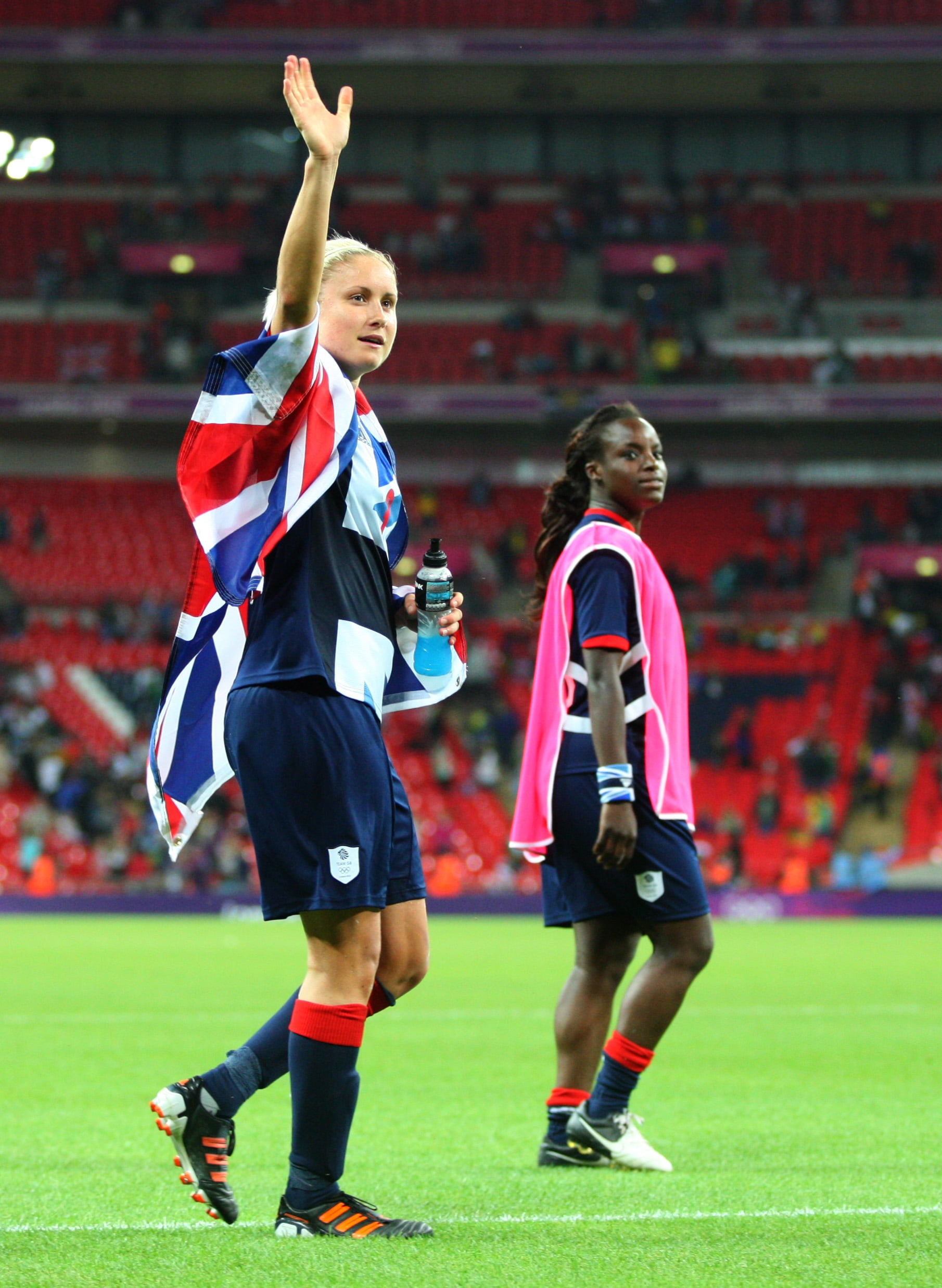 Stephanie Houghton of Team GB Women waves to the fans at the end of the match wearing a Union Jack flag during the 2012 London Olympic Summer Games at Wembley Stadium, London, England, UK on July 31st 2012 (Photo by AMA/Corbis via Getty Images)