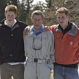 The brothers had their arms around Prince Charles during a 2002 ski trip in Switzerland.