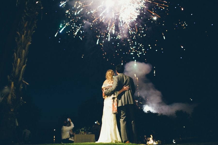 The bride and groom watched the fireworks at their Little Elm, Texas, wedding.