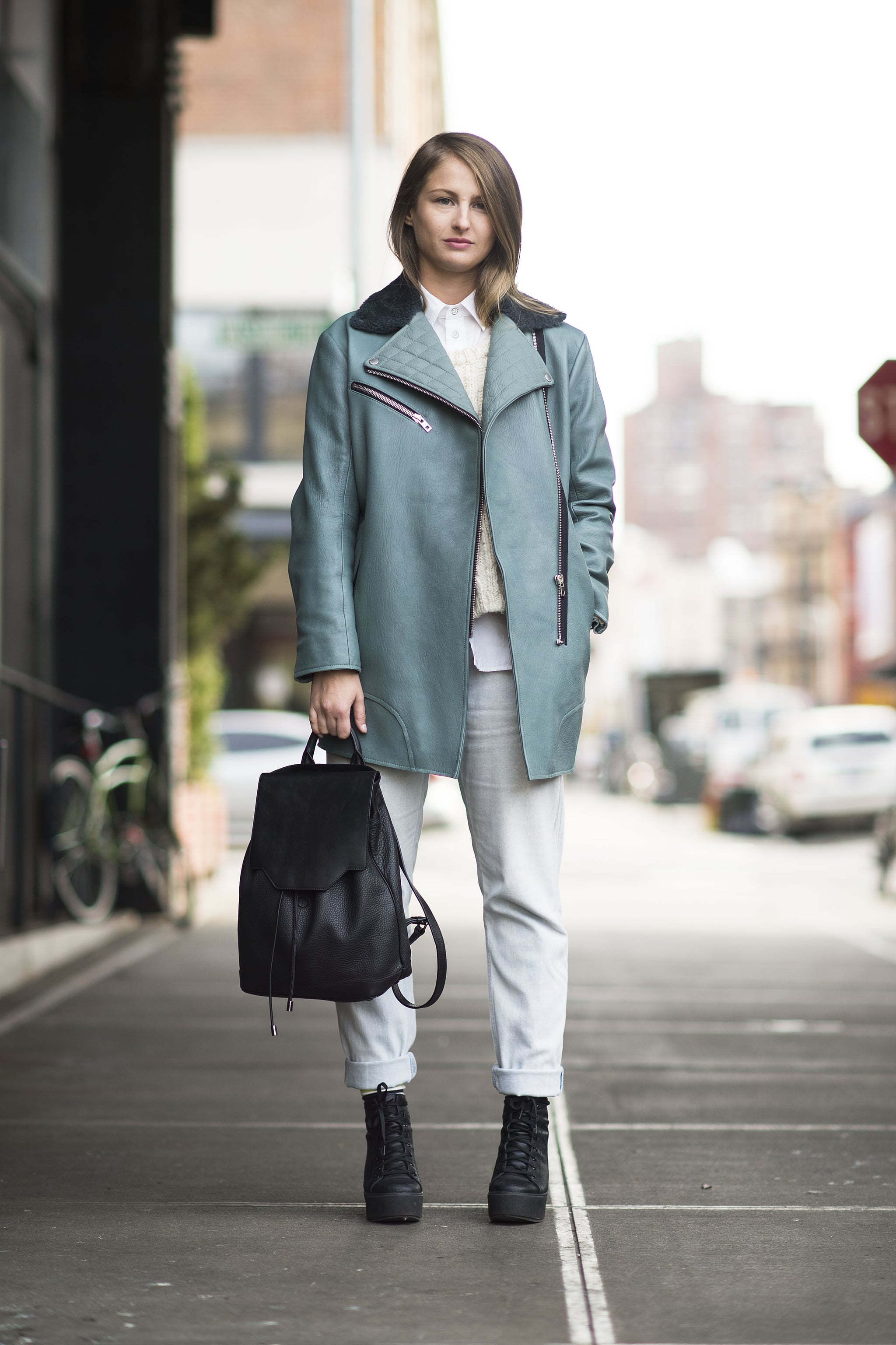 Winter doesn't have to mean gray days: this street style pro added interest with a blue-hued leather jacket and white jeans. Source: Le 21ème | Adam Katz Sinding
