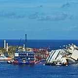 Barges surrounded the wreckage of the ship, which crashed into the rocks more than a year and a half ago.