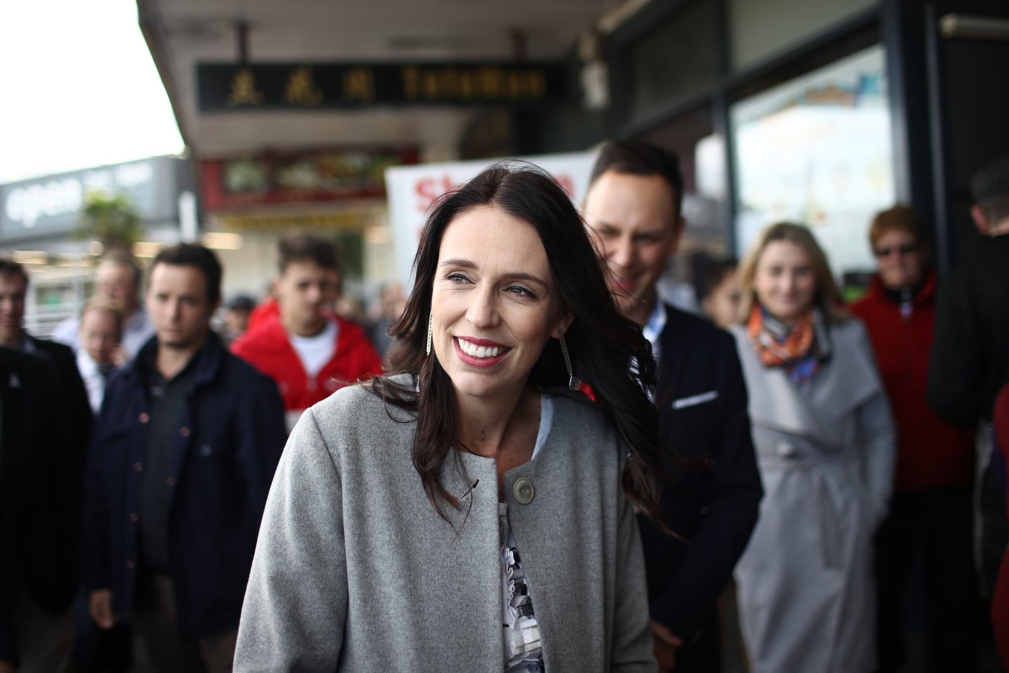 AUCKLAND, NEW ZEALAND - JUNE 07:  Prime Minister Jacinda Ardern and Northcote Labour candidate Shanan Halbert meet shoppers at the Northcote Shopping Centre on June 7, 2018 in Auckland, New Zealand. The Northcote by-election will be held on Saturday 9 June. The seat became vacant on 15 April 2018, following the resignation of Jonathan Coleman.  (Photo by Phil Walter/Getty Images)