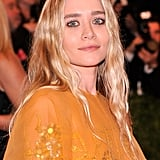 Ashley Olsen's style was a mirror of the grunge era with mussed waves and thick eyeliner at the Met Gala.