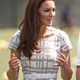 The Duchess cinched in her Hobbs dress with a white belt.