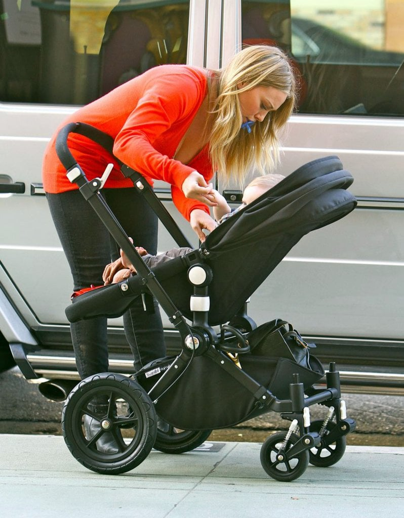 Hilary Duff strapped Luca Comrie into his stroller.