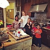 Chrissy Teigen hung out with family members in the kitchen.
