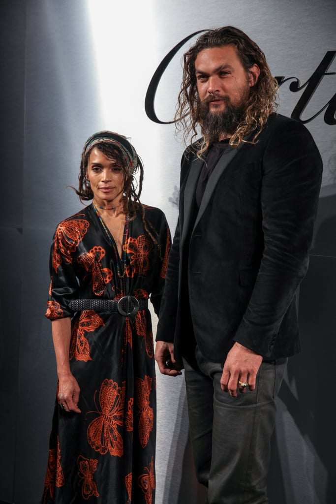 """Jason Momoa and Lisa Bonet made their first joint appearance of the year when they stepped out for Cartier's watch launch party in San Francisco on Thursday night. The couple stunned, as per usual, and held hands while posing for pictures. Jason also shared a photo of him and Lisa with pal Jeremy Renner at the event on Instagram, writing, """"Me and wifey partying in San Francisco great music old friends new friends free drinks BOOM mahalo @cartier for inviting us we had a ball.""""  The last time we saw Jason and Lisa together on the red carpet was back in November 2017 at the LA premiere of Justice League. However, we did see Lisa just last month at Vanity Fair's Oscars party with her 29-year-old daughter, Zoë Kravitz."""
