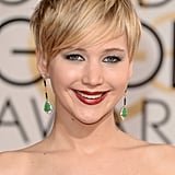 Who says you can't rock a statement eye and lip? Not Jennifer Lawrence! The star's whimsical pixie cut framed her face beautifully, while her silver eye shadow and berry lip upped the high-fashion factor.