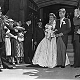 """Jackie and John's first dance was to """"I Married an Angel."""" After dining on creamed chicken, pineapple salad, and ice cream, the newlyweds shared their first dance to a performance by Meyer Davis and his orchestra."""