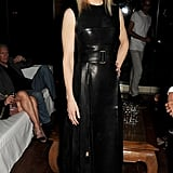 Nicole Kidman edged up her look in a black leather fit-and-flare Calvin Klein Collection dress, finished with gold drop earrings and Jimmy Choo pumps.