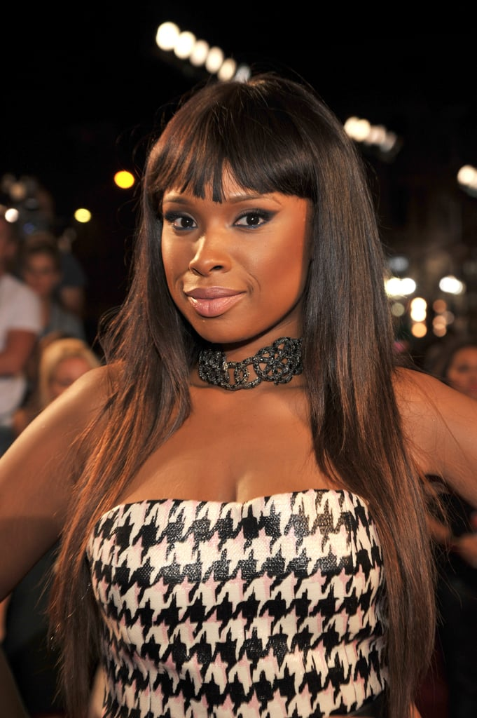 Blunt bangs called attention to Jennifer Hudson's dramatic eye makeup at the VMAs, a look she balanced with a petal pink lip hue.