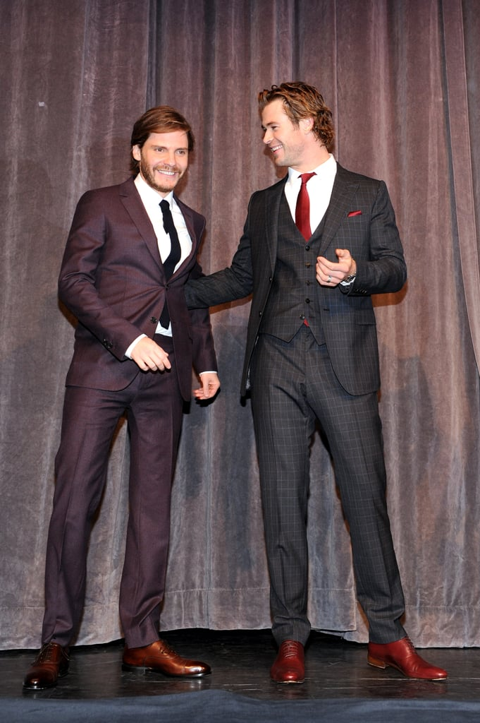 Chris Hemsworth and Daniel Brühl looked anything but adversarial as they introduced Rush.