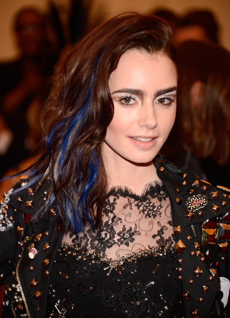 Lily Collins added some blue to her beach waves for the Met Gala.