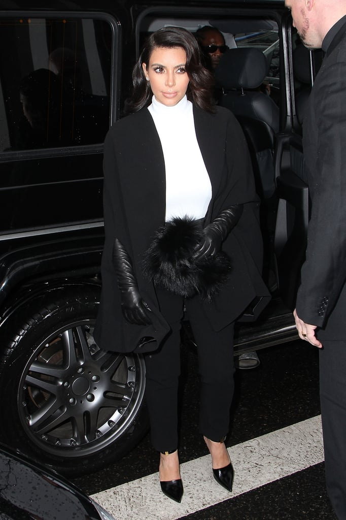 She added long leather opera gloves and a black fur clutch to her already-sleek ensemble.