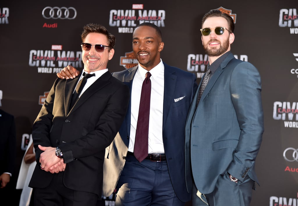 The ridiculously handsome cast of Captain America: Civil War — Chris Evans, Robert Downey Jr., and Anthony Mackie — all came together for the film's LA premiere on Tuesday evening. On top of steaming up the red carpet with their sexy smolders, the men showed off their adorable offscreen chemistry, sharing a handful of laughs and hugs while posing for photographers. The trio's gorgeous costar, Emily Van Camp, also popped up at the event, and upon seeing these pictures, we couldn't help but notice just how much she reminded us of Emily Thorne from Revenge.  April is already shaping up to be a big month for Chris, who recently revealed a very important detail about himself during an appearance on Anna Faris's podcast, Anna Faris Is Unqualified. After hitting up the MTV Awards and posing backstage with the ever-dapper Chris Hemsworth, the actor was spotted outside of Jimmy Kimmel Live's LA studio looking so damn good. Keep reading for more snaps, and then check out all the times Chris simply could not contain his muscles.