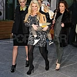 Pregnant Jessica Simpson carrying Bronx.