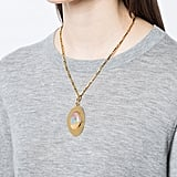 Layer this Lizzie Fortunato Jewels Mountain Valley Pendant ($350) with some of your favorite shorter-length styles or try it on its own with a deep v-neck.