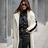 Work a flashy pantsuit underneath your going-out coat so you look chic as hell once you shed that top layer and perfectly put together on the street if you're wearing your jacket open.