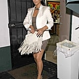 Kim Kardashian carried a white bag leaving the salon.