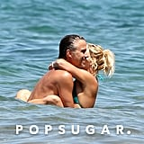 Her then-boyfriend Jason Trawick couldn't hide his smile as Britney wrapped her body around him in Maui, HI, in August 2010.