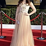 Modern Family's Ariel Winter bloomed in a floral embellished tulle skirt gown with loose curls and a dazzling cocktail ring.