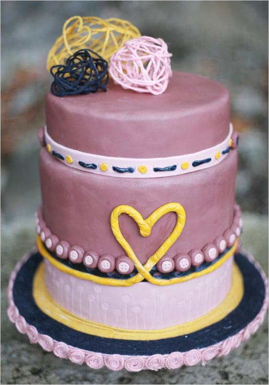It's all about the sweet details when it comes to this purple, memorable cake, from the heart to the buttons and everything in between.