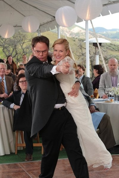 Dwight literally sweeps Angela off her feet for the first dance.