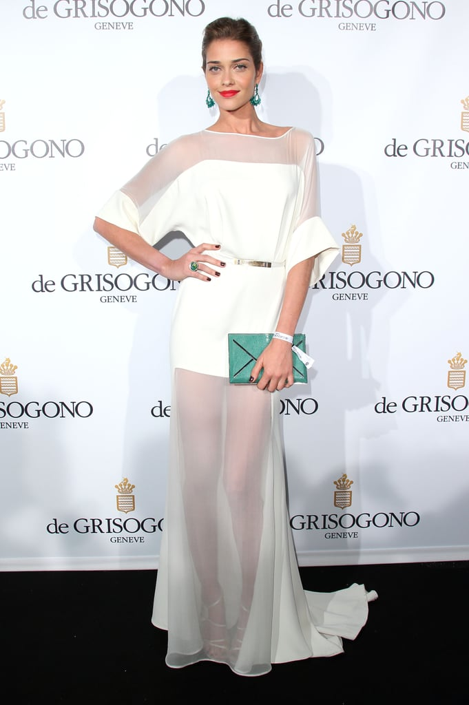 Ana Beatriz Barros was ethereal in her white sheer gown at the de Grisogono party at Cannes. Green add-ons added lots of flair.