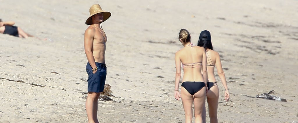 Orlando Bloom Looks Incredibly Ripped While Chatting Up Bikini-Clad Women on the Beach