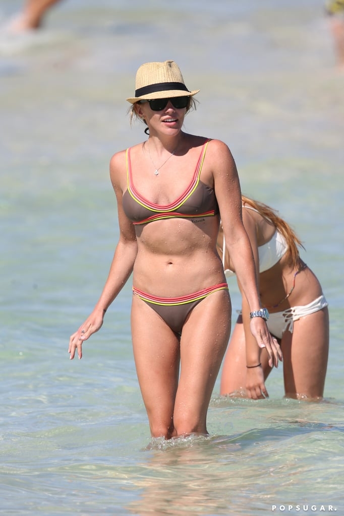 Katie Cassidy can sure rock the hell out of a bikini! On Sunday, the Arrow star hit the beach with a couple of friends in Miami, looking like her usual hot self. Clad in a sexy two-piece, the actress put her fit figure and rock-hard abs on display while splashing around in the ocean. Of course, this isn't the first time we've gotten a peek at Katie's bangin' bikini body. Earlier this year, the star flaunted her enviable curves during a romantic getaway with boyfriend Thomas Taylor before linking up with her equally gorgeous costar Emily Bett Rickards in Miami. Grab a cold towel and keep reading for more of Katie's steamy vacation, and then check out the hottest bikini moments of 2016 — so far!