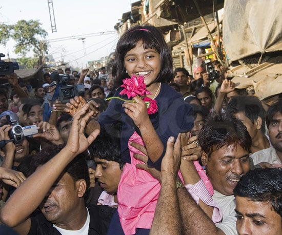 Photo of Slumdog Millionaire's Rubina Ali Being Welcomed Back to Mumbai