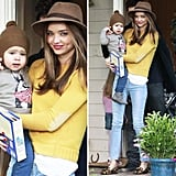 We can't get enough of Miranda Kerr's yellow elbow-patch sweater and leopard-print loafers.