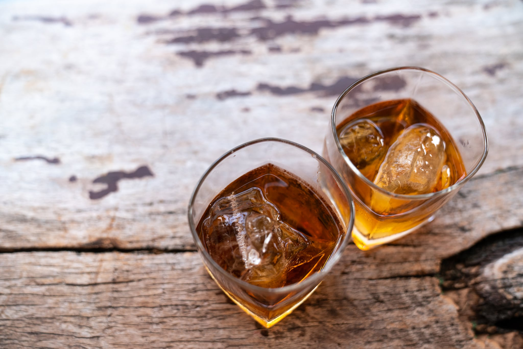 Two rye whiskey cocktail drinks toasted together,Addictive substance