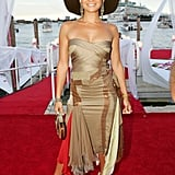 Mixing a body-con strapless and bold accessories on the red carpet for the 2004 MTV Movie Awards.