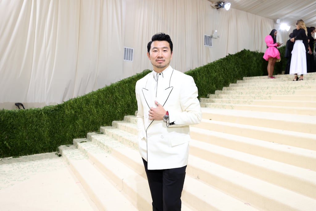 """It's been a big month for Simu Liu. Just a week after the successful release of Marvel's Shang-Chi and the Legend of the Ten Rings, in which he plays the titular character, Simu attended the Met Gala for the first time ever! The actor looked incredibly dashing, wearing a classic black-and-white suit by Fendi. """"It was a wild one,"""" Simu wrote on Instagram at the end of the night. He added, """"I'm sorry to all the people whose dresses I stepped on. Please know that it was 100% on purpose. No I'm kidding really I'm so sorry I felt so bad."""" We have a feeling even that wouldn't hinder his chances at a future invite. Enjoy photos of his very attractive red carpet appearance ahead.      Related:                                                                                                           I Was Not Prepared For the Cuteness of Rihanna and A$AP Rocky's First Met Gala as a Couple"""