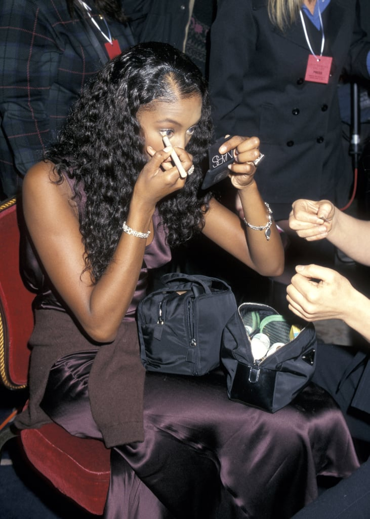 Naomi Campbell touched up her own eye makeup backstage in 2001.
