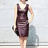 Violante Placido opted for a slick burgundy leather cocktail dress with bow-tie pumps for her front-row look at Emporio Armani.