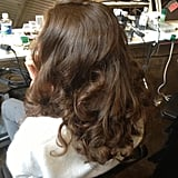 """If you're just looking to wear these curls for the ceremony, take Dimachki's advice for a long-lasting style. """"Using a mousse to get a great foundation will really secure the look and give that coarseness and extra grip when you do curl, and let the heat sit on — don't be shy,"""" she said."""