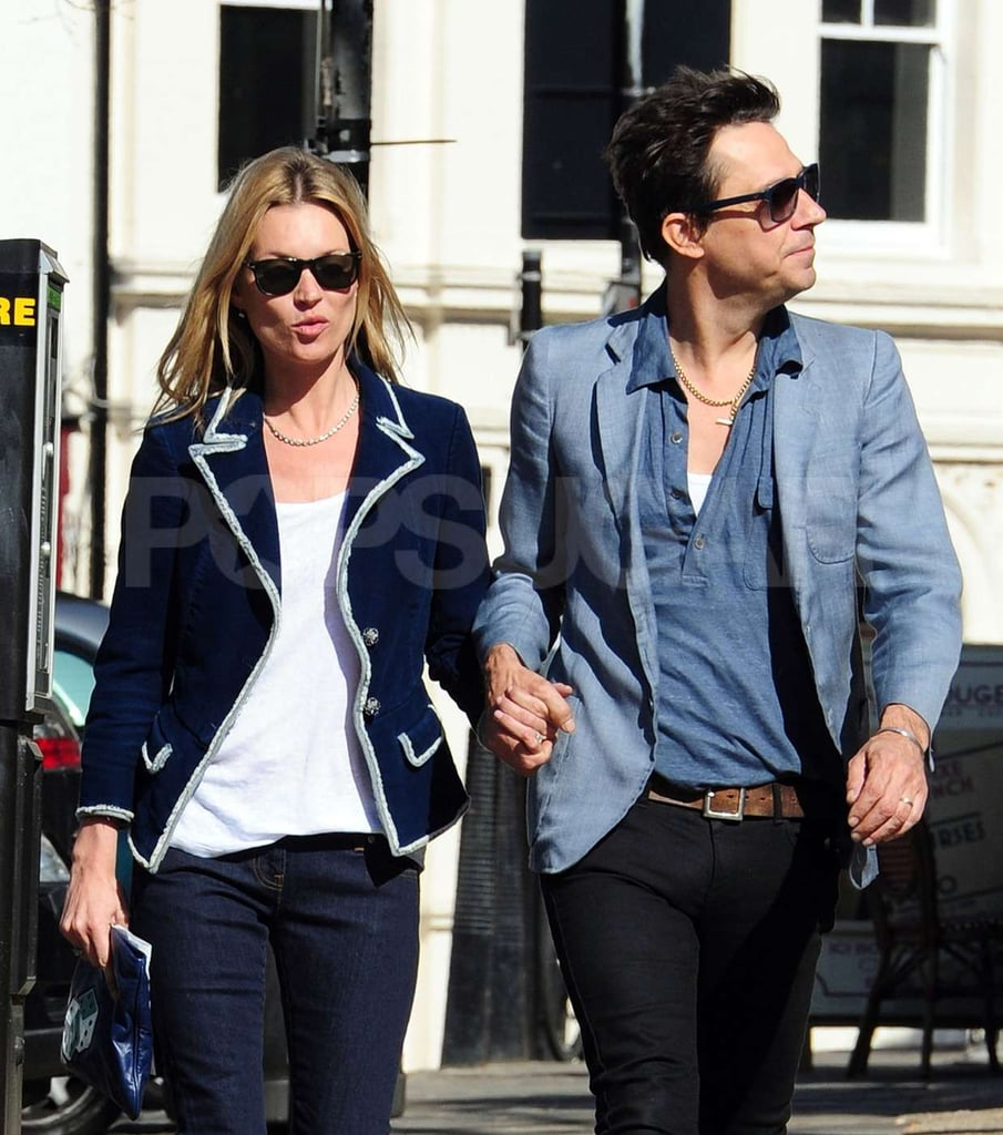 Kate Moss and Jamie Hince hold hands as they take a walk in London.