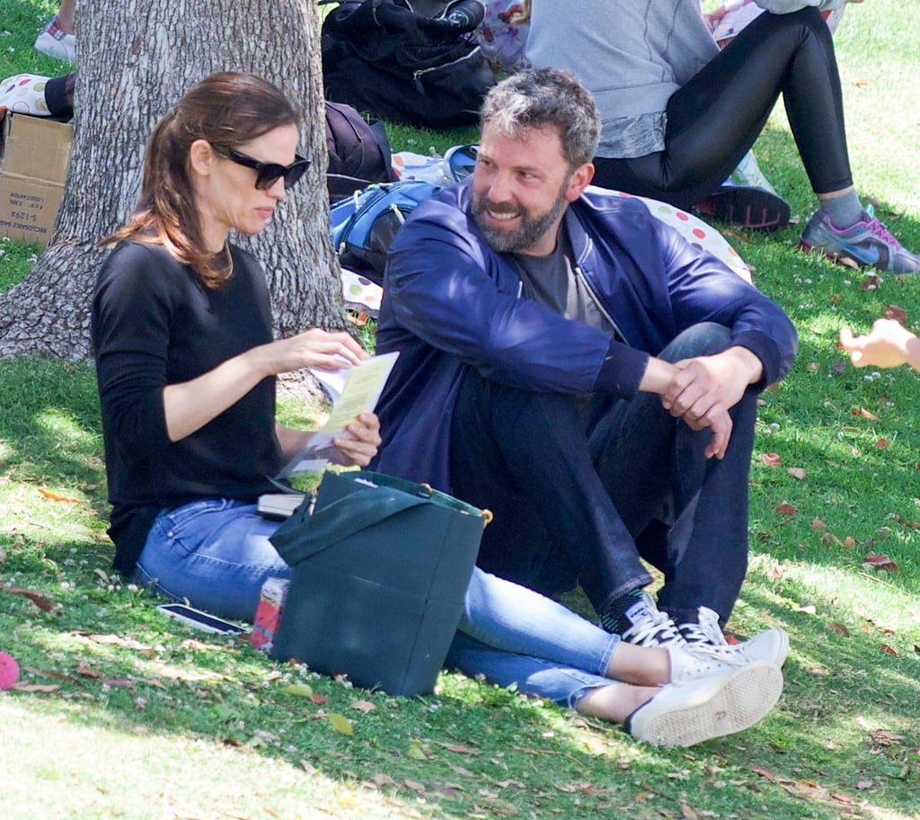"When Jennifer Garner and Ben Affleck announced their plans to divorce back in June 2015, they made it clear that they would remain friendly and committed to coparenting their three kids, Violet, Seraphina, and Samuel. Since then, they've been spotted on multiple outings together and opened up about their ""modern family."" On Saturday, the former couple were spotted at a park in LA, sitting together in the grass while their children played. Jen and Ben both seemed happy and relaxed, even letting out a few laughs as they hung out under a shady tree.      Related:                                                                                                           The Way They Were: 5 Things You Never Knew About Ben and Jen's Wedding               Ben recently finished filming the Netflix movie Triple Frontier with Charlie Hunnam, Garrett Hedlund, and Oscar Isaac in Hawaii. Back in March, he showed off his massive back tattoo on the beach and made time for some water sports with girlfriend Lindsay Shookus. Despite the potential awkwardness, Jen made sure that she and the kids were in Hawaii to spend Easter together with Ben. Coparenting at its finest."