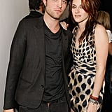 Robert Pattinson looked hot in a black ensemble while posing with Kristen Stewart at the 2008 filming of MTV's Spoiler, where the two shared a sneak peek of the Twilight movie.