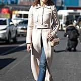 With a Cream Jacket, Black Tights, and White Sneakers