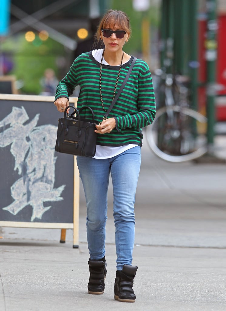 Rashida Jones kept things laid-back in black Isabel Marant sneakers, denim skinnies, and a bright striped sweater.