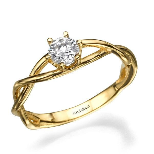 What's more everlasting than infinity? A 14k yellow gold engagement ring ($1,250) seals the deal.