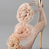 The most feminine complement to your wedding day gown.  Giuseppe Zanotti Chiffon Rosette Sandals ($750)